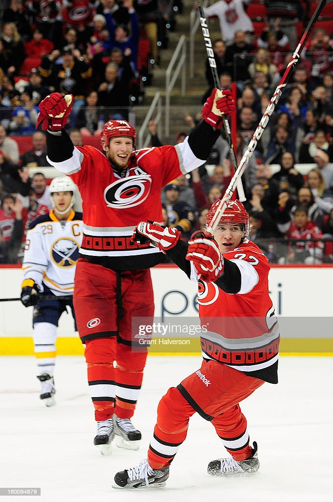 Jordan Staal #11 and Zac Dalpe #22 celebrate a goal by Jeff Skinner #53 of the Carolina Hurricanes against the Buffalo Sabres during play at PNC Arena on January 24, 2013 in Raleigh, North Carolina. Carolina defeated Buffalo, 6-3.