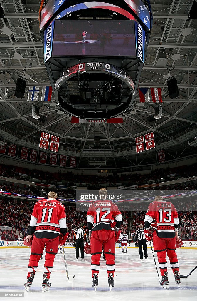 Jordan Staal #11, Eric Staal #12 and Jared Staal #13 of the Carolina Hurricanes are pictured during the National Anthem prior to an NHL game against the New York Rangers at PNC Arena on April 25, 2013 in Raleigh, North Carolina. Eric and Jordan Staal will be joined by 22-year-old brother Jared for the first time in a Hurricanes sweater as he makes his NHL debut tonight.