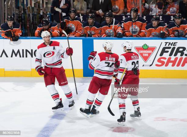 Jordan Staal Jaccob Slavin and Brett Pesce of the Carolina Hurricanes celebrate a goal against the Edmonton Oilers on October 17 2017 at Rogers Place...