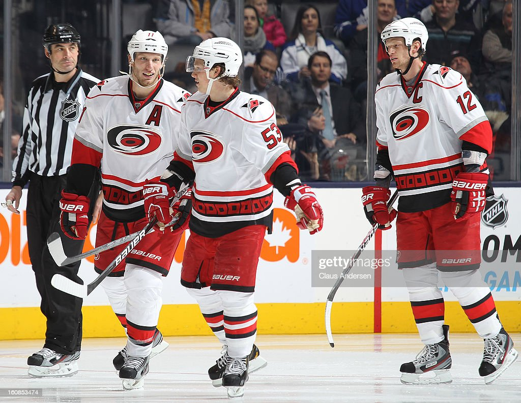 Jordan Staal #11, Jeff Skinner #53 and Eric Staal #12 of the Carolina Hurricanes skate back to the bench after a goal in a game against the Toronto Maple Leafs on February 4, 2013 at the Air Canada Centre in Toronto, Canada. The Hurricanes defeated the Leafs 4-1.