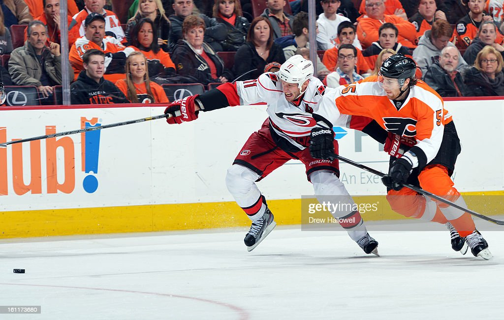 <a gi-track='captionPersonalityLinkClicked' href=/galleries/search?phrase=Jordan+Staal&family=editorial&specificpeople=533044 ng-click='$event.stopPropagation()'>Jordan Staal</a> #11 of the Carolina Hurricanes and <a gi-track='captionPersonalityLinkClicked' href=/galleries/search?phrase=Braydon+Coburn&family=editorial&specificpeople=2077063 ng-click='$event.stopPropagation()'>Braydon Coburn</a> #5 of the Philadelphia Flyers fight for the puck at the Wells Fargo Center on February 9, 2013 in Philadelphia, Pennsylvania. The Flyers won 4-3 in overtime.