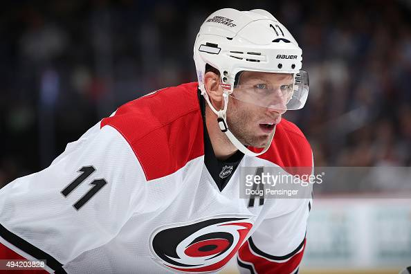 Jordan Staal of the Carolina Hurricanes awaits a face off against the Colorado Avalanche at Pepsi Center on October 21 2015 in Denver Colorado The...