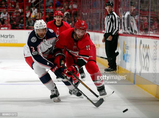 Jordan Staal of the Carolina Hurricanes battles for a loose puck with Seth Jones of the Columbus Blue Jackets during an NHL game on October 10 2017...