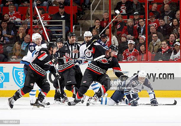 Jordan Staal of the Carolina Hurricanes battles in the crease with Jeff Skinner and Chad LaRose against Ollie Jokinen Bryan Little and Dustin...