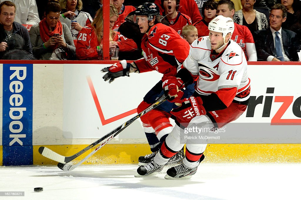 <a gi-track='captionPersonalityLinkClicked' href=/galleries/search?phrase=Jordan+Staal&family=editorial&specificpeople=533044 ng-click='$event.stopPropagation()'>Jordan Staal</a> #11 of the Carolina Hurricanes brings the puck up ice during the third period of an NHL game against the Washington Capitals at Verizon Center on February 26, 2013 in Washington, DC.