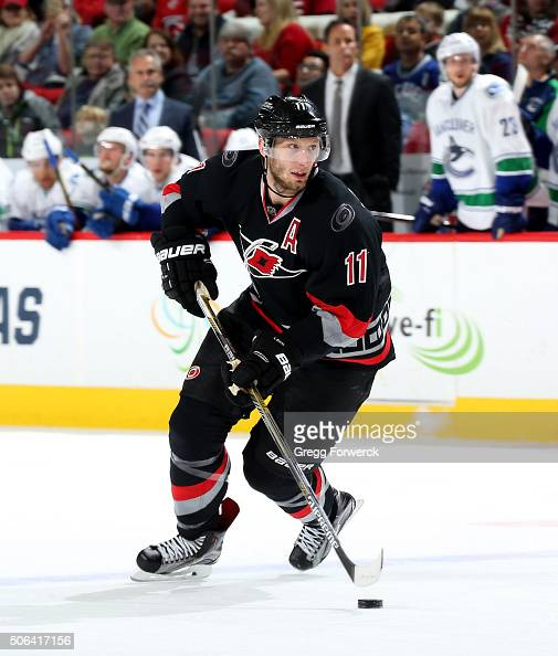 Jordan Staal of the Carolina Hurricanes carries the puck during an NHL game against the Vancouver Canucks at PNC Arena on January 15 2016 in Raleigh...