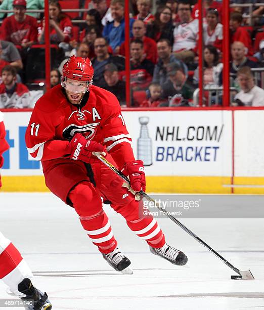 Jordan Staal of the Carolina Hurricanes carries the puck during their NHL game against the Detroit Red Wings at PNC Arena on April 11 2015 in Raleigh...