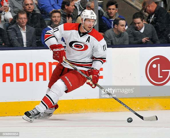 Jordan Staal of the Carolina Hurricanes carries the puck up ice against the Toronto Maple Leafs during game action on January 21 2016 at Air Canada...