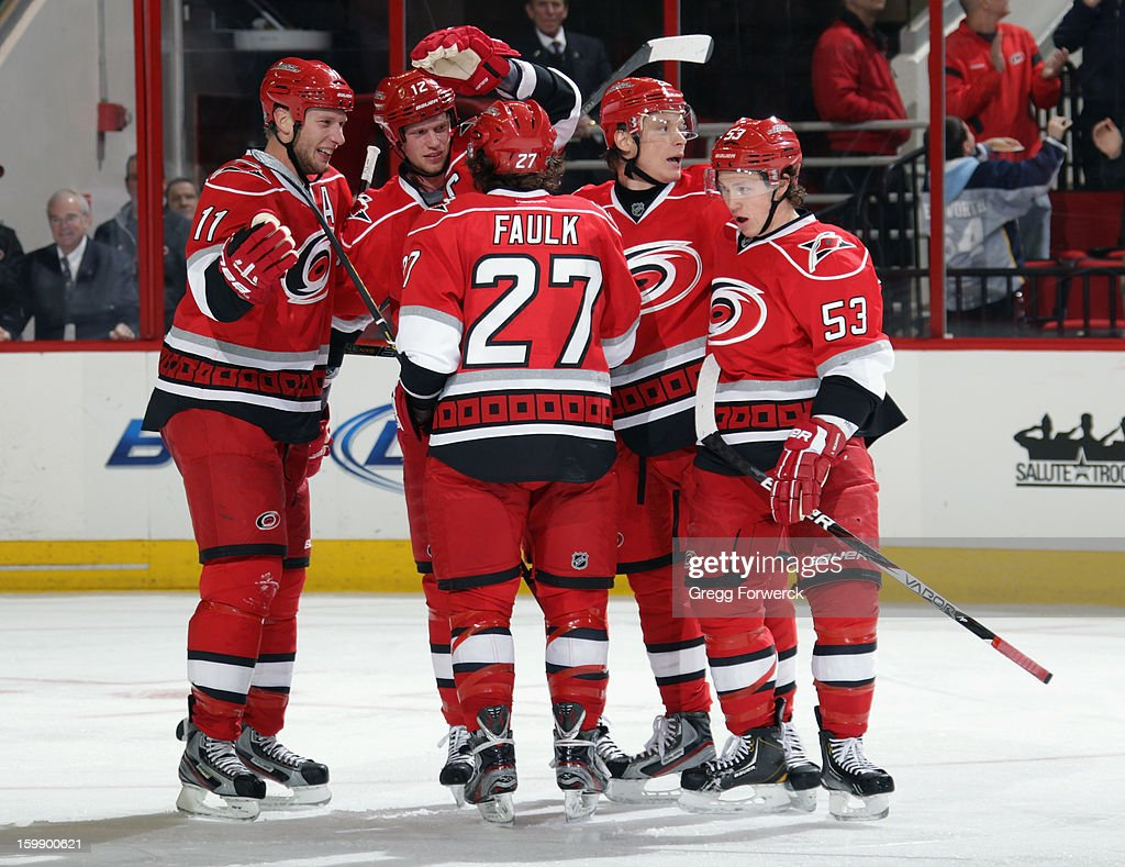 Jordan Staal #11 of the Carolina Hurricanes celebrates a goal scored by Jeff Skinner #53 with teammates Eric Staal #12, Justin Faulk #27, and Alexander Semin #28 during an NHL game against the Tampa Bay Lightning on January 22, 2013 at PNC Arena in Raleigh, North Carolina.