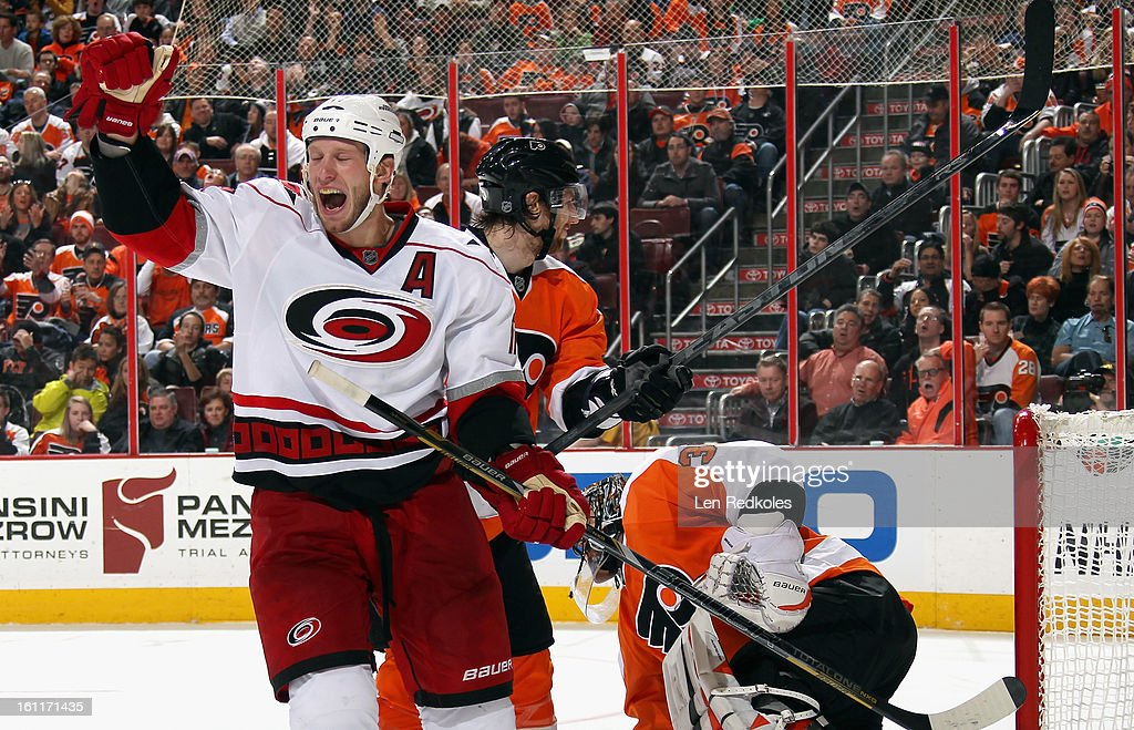 Jordan Staal #11 of the Carolina Hurricanes celebrates a second period goal by teammate Jeff Skinner #53(not pictured) against Ilya Bryzgalov #30 of the Philadelphia Flyers on February 9, 2013 at the Wells Fargo Center in Philadelphia, Pennsylvania.