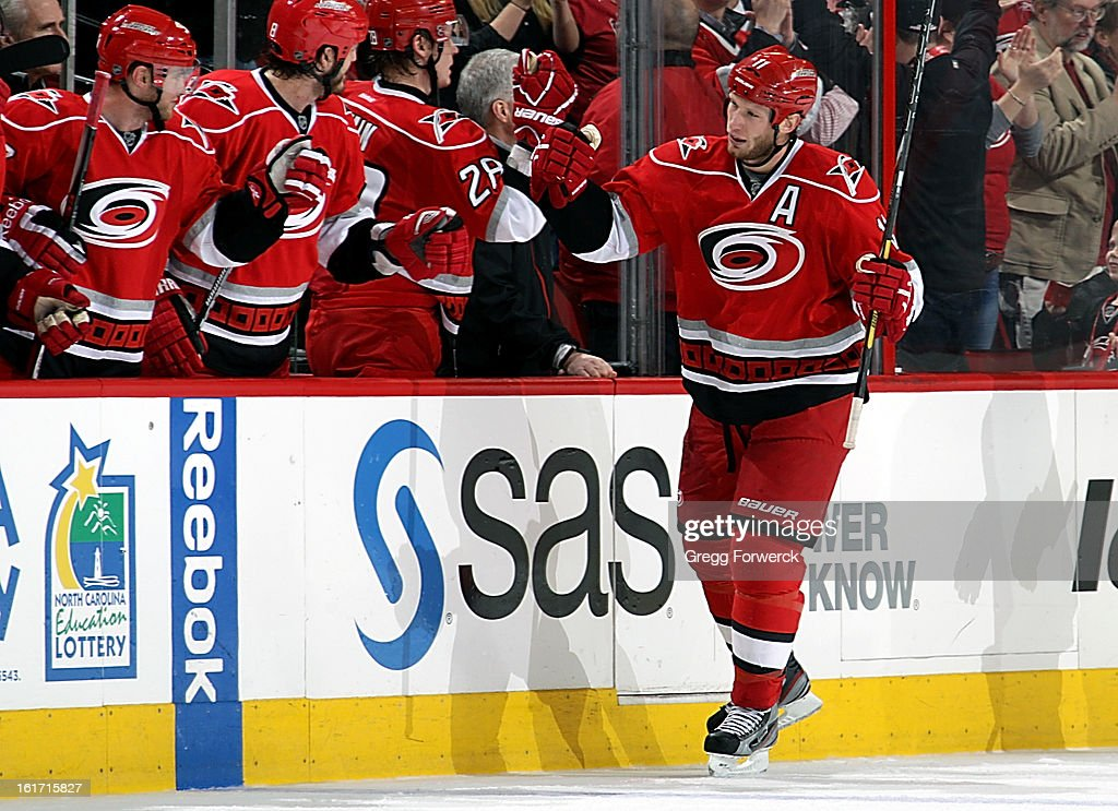 Jordan Staal #11 of the Carolina Hurricanes celebrates his second-period goal against the Toronto Maple Leafs with teammates at the home bench during their NHL game at PNC Arena on February 14, 2013 in Raleigh, North Carolina.