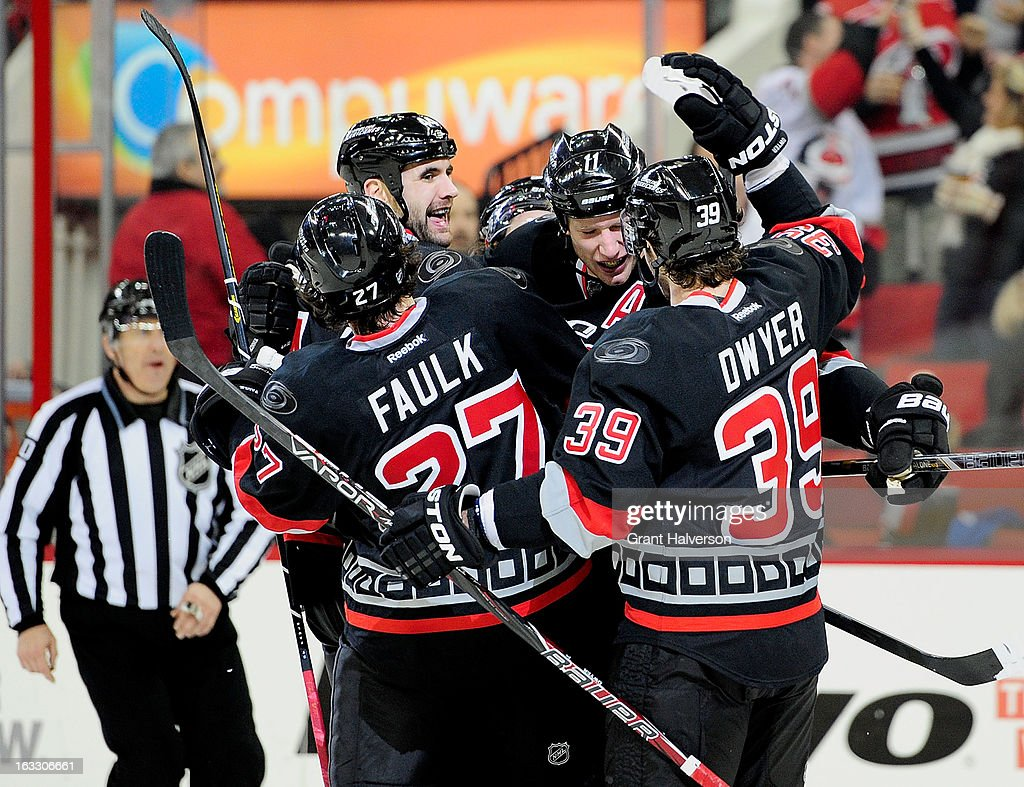 <a gi-track='captionPersonalityLinkClicked' href=/galleries/search?phrase=Jordan+Staal&family=editorial&specificpeople=533044 ng-click='$event.stopPropagation()'>Jordan Staal</a> #11 of the Carolina Hurricanes celebrates with teammates after his goal against the Montreal Canadiens during the second period at PNC Arena on March 7, 2013 in Raleigh, North Carolina.