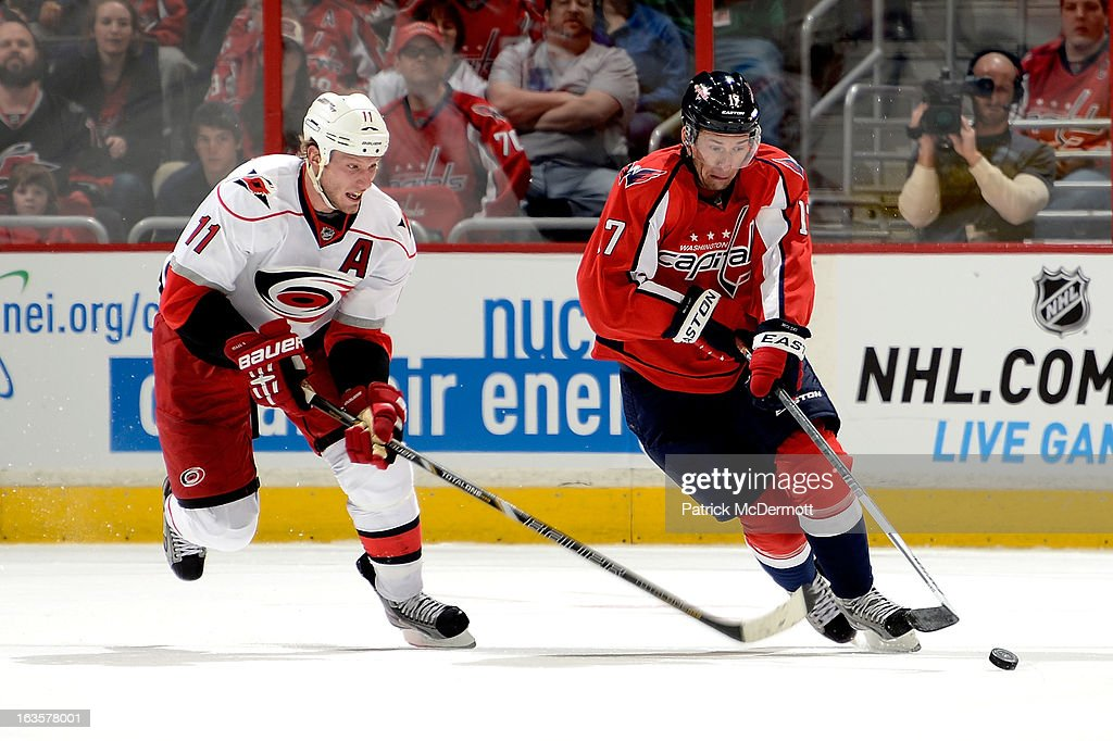 <a gi-track='captionPersonalityLinkClicked' href=/galleries/search?phrase=Jordan+Staal&family=editorial&specificpeople=533044 ng-click='$event.stopPropagation()'>Jordan Staal</a> #11 of the Carolina Hurricanes chases as <a gi-track='captionPersonalityLinkClicked' href=/galleries/search?phrase=Wojtek+Wolski&family=editorial&specificpeople=240466 ng-click='$event.stopPropagation()'>Wojtek Wolski</a> #17 of the Washington Capitals brings the puck up ice during the first period of an NHL game at Verizon Center on March 12, 2013 in Washington, DC.