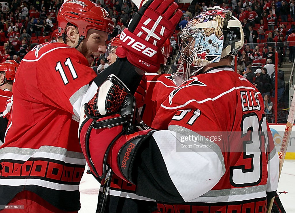 <a gi-track='captionPersonalityLinkClicked' href=/galleries/search?phrase=Jordan+Staal&family=editorial&specificpeople=533044 ng-click='$event.stopPropagation()'>Jordan Staal</a> #11 of the Carolina Hurricanes congratulates <a gi-track='captionPersonalityLinkClicked' href=/galleries/search?phrase=Dan+Ellis&family=editorial&specificpeople=2235265 ng-click='$event.stopPropagation()'>Dan Ellis</a> #31 following their victory over the Toronto Maple Leafs at PNC Arena on February 14, 2013 in Raleigh, North Carolina.