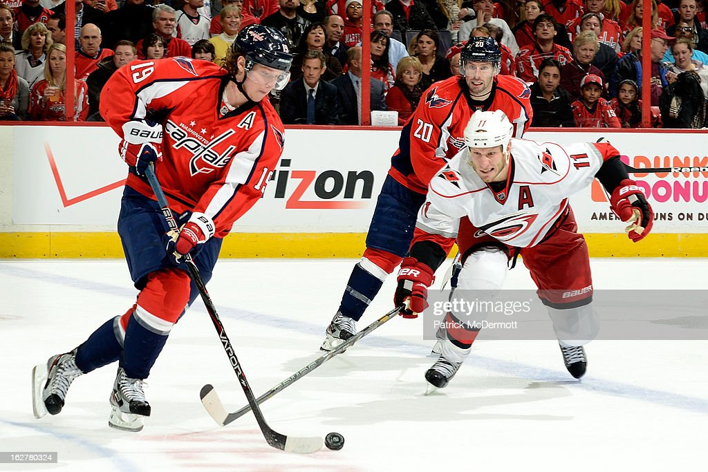 <a gi-track='captionPersonalityLinkClicked' href=/galleries/search?phrase=Jordan+Staal&family=editorial&specificpeople=533044 ng-click='$event.stopPropagation()'>Jordan Staal</a> #11 of the Carolina Hurricanes defends as Nicklas Backstrom #19 of the Washington Capitals brings the puck into the zone in the third period of an NHL game at Verizon Center on February 26, 2013 in Washington, DC.