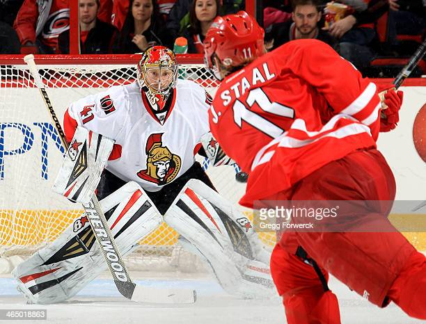 Jordan Staal of the Carolina Hurricanes fires a shot on Craig Anderson of the Ottawa Senators during their NHL game at PNC Arena on January 25 2014...