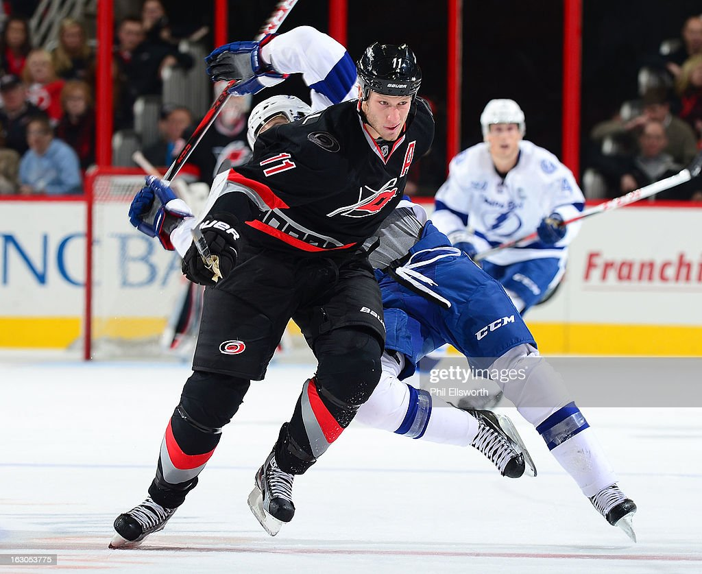 <a gi-track='captionPersonalityLinkClicked' href=/galleries/search?phrase=Jordan+Staal&family=editorial&specificpeople=533044 ng-click='$event.stopPropagation()'>Jordan Staal</a> #11 of the Carolina Hurricanes gains position on a Tampa Bay Lightning player during an NHL game on February 23, 2013 at PNC Arena in Raleigh, North Carolina.