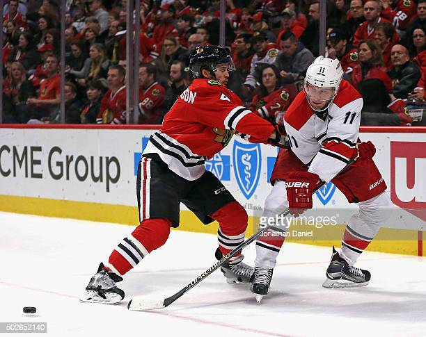 Jordan Staal of the Carolina Hurricanes gets off a shot around Niklas Hjalmarsson of the Chicago Blackhawks at the United Center on December 27 2015...
