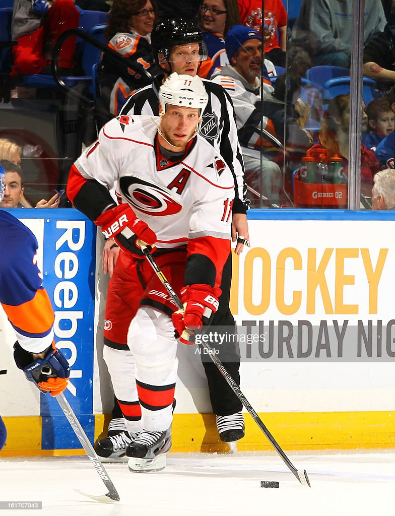 <a gi-track='captionPersonalityLinkClicked' href=/galleries/search?phrase=Jordan+Staal&family=editorial&specificpeople=533044 ng-click='$event.stopPropagation()'>Jordan Staal</a> #11 of the Carolina Hurricanes in action against the New York Islanders during their game at Nassau Veterans Memorial Coliseum on February 11, 2013 in Uniondale, New York.