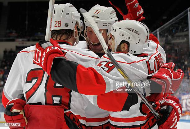 Jordan Staal of the Carolina Hurricanes is congratulated by teammates Alexander Semin and Chad LaRose on his second period goal during the game...