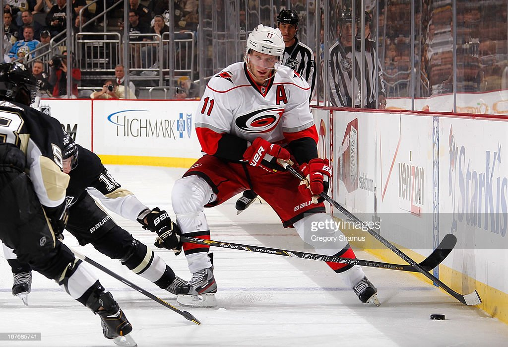 <a gi-track='captionPersonalityLinkClicked' href=/galleries/search?phrase=Jordan+Staal&family=editorial&specificpeople=533044 ng-click='$event.stopPropagation()'>Jordan Staal</a> #11 of the Carolina Hurricanes moves the puck in front of <a gi-track='captionPersonalityLinkClicked' href=/galleries/search?phrase=Brandon+Sutter&family=editorial&specificpeople=2086411 ng-click='$event.stopPropagation()'>Brandon Sutter</a> #16 of the Pittsburgh Penguins on April 27, 2013 at Consol Energy Center in Pittsburgh, Pennsylvania.