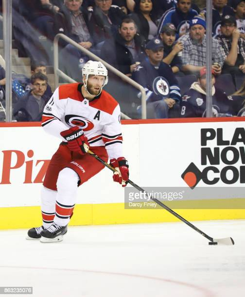 Jordan Staal of the Carolina Hurricanes plays the puck down the ice during third period action against the Winnipeg Jets at the Bell MTS Place on...