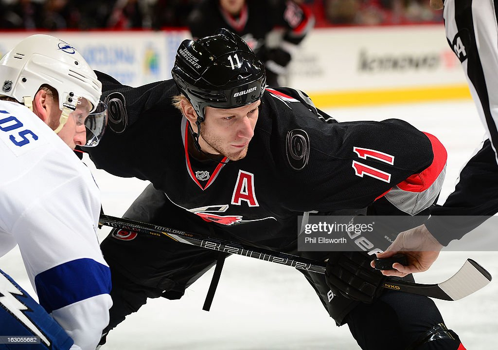 <a gi-track='captionPersonalityLinkClicked' href=/galleries/search?phrase=Jordan+Staal&family=editorial&specificpeople=533044 ng-click='$event.stopPropagation()'>Jordan Staal</a> #11 of the Carolina Hurricanes prepares for a face-off against <a gi-track='captionPersonalityLinkClicked' href=/galleries/search?phrase=Steven+Stamkos&family=editorial&specificpeople=4047623 ng-click='$event.stopPropagation()'>Steven Stamkos</a> #91 of the Tampa Bay Lightning during an NHL game on February 23, 2013 at PNC Arena in Raleigh, North Carolina.