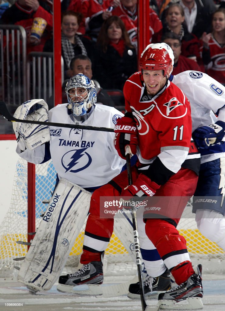 Jordan Staal #11 of the Carolina Hurricanes prepares for a shot on goal as Mathieu Garon #32 of the Tampa Bay Lightning readies in the crease during an NHL game against the Tampa Bay Lightning on January 22, 2013 at PNC Arena in Raleigh, North Carolina.