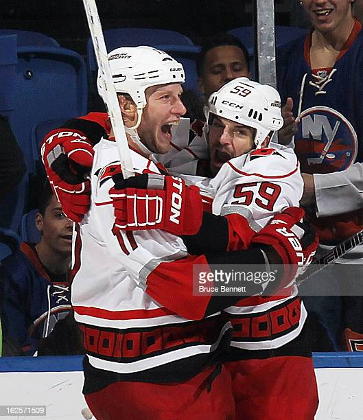 Jordan Staal of the Carolina Hurricanes scores the tying goal at 1913 of the second period against the New York Islanders and is joined by Chad...