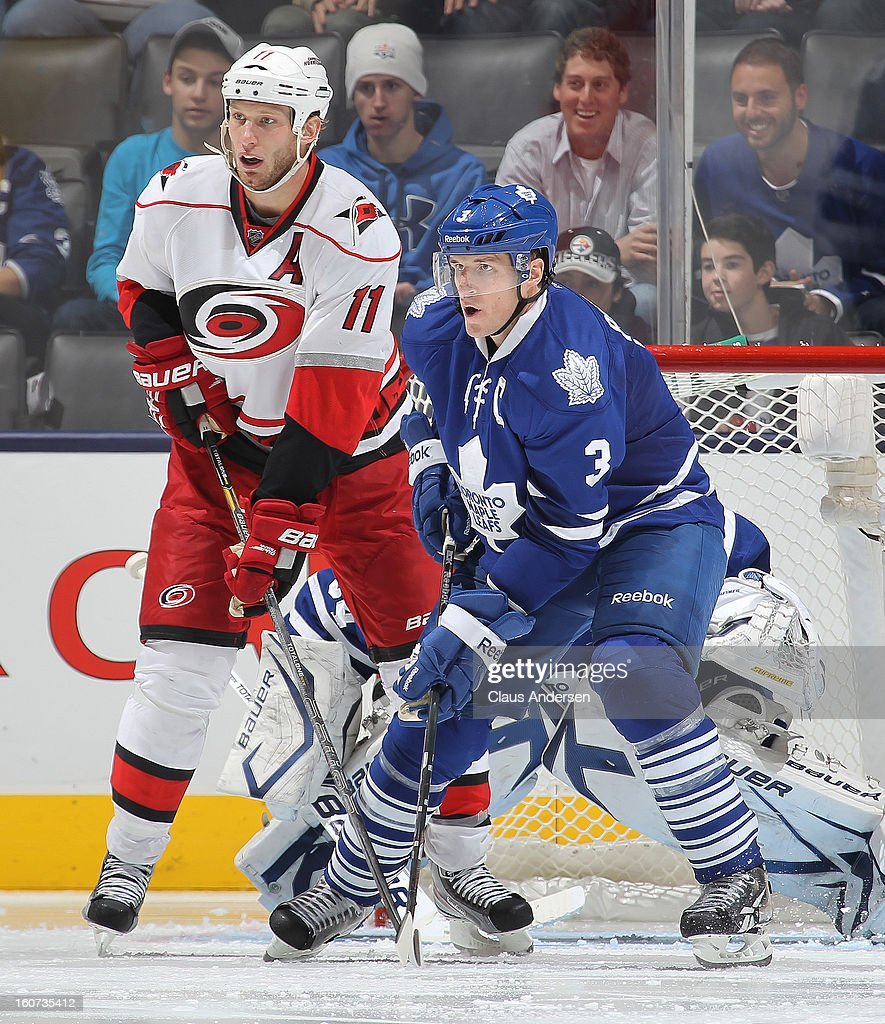 <a gi-track='captionPersonalityLinkClicked' href=/galleries/search?phrase=Jordan+Staal&family=editorial&specificpeople=533044 ng-click='$event.stopPropagation()'>Jordan Staal</a> #11 of the Carolina Hurricanes skates against <a gi-track='captionPersonalityLinkClicked' href=/galleries/search?phrase=Dion+Phaneuf&family=editorial&specificpeople=545455 ng-click='$event.stopPropagation()'>Dion Phaneuf</a> #3 of the Toronto Maple Leafs in a game on February 4, 2013 at the Air Canada Centre in Toronto, Canada. The Hurricanes defeated the Leafs 4-1.