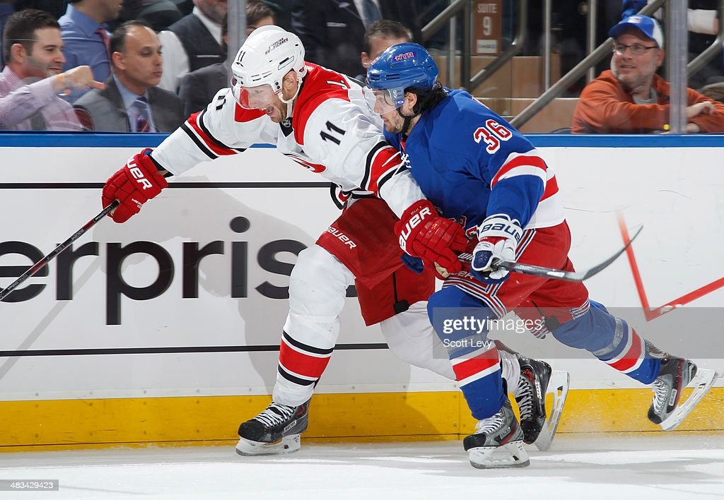 Jordan Staal #11 of the Carolina Hurricanes skates against Mats Zuccarello #36 of the New York Rangers at Madison Square Garden on April 08, 2014 in New York City.