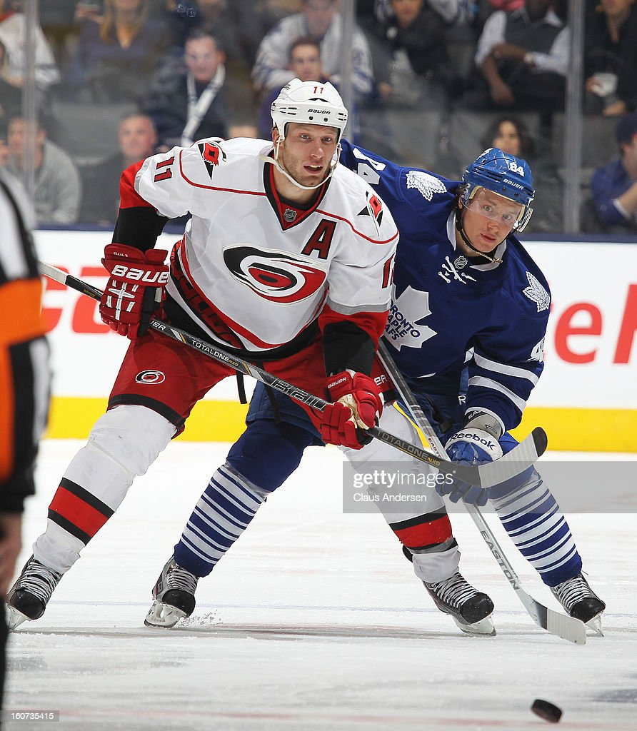 Jordan Staal #11 of the Carolina Hurricanes skates against Mikhail Grabovski #84 of the Toronto Maple Leafs in a game on February 4, 2013 at the Air Canada Centre in Toronto, Canada. The Hurricanes defeated the Leafs 4-1.