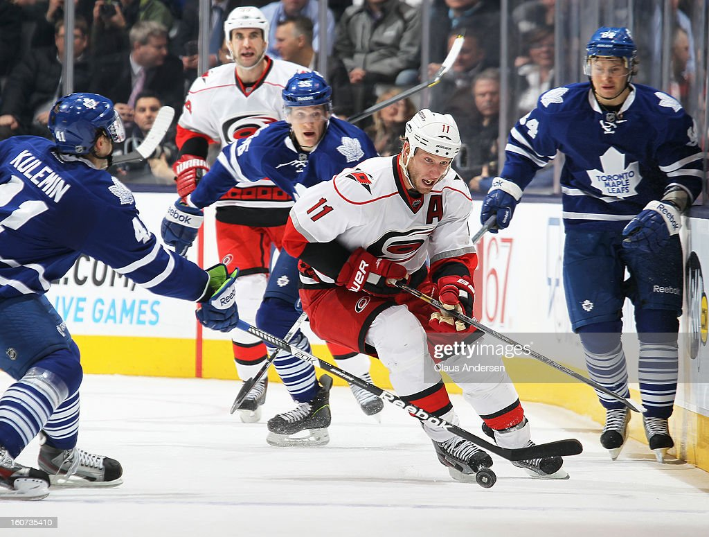 Jordan Staal #11 of the Carolina Hurricanes skates for a loose puck in a game against the Toronto Maple Leafs on February 4, 2013 at the Air Canada Centre in Toronto, Canada. The Hurricanes defeated the Leafs 4-1.