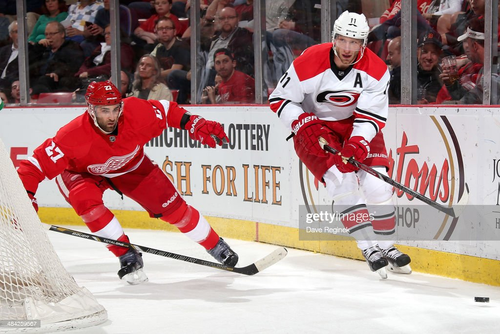 <a gi-track='captionPersonalityLinkClicked' href=/galleries/search?phrase=Jordan+Staal&family=editorial&specificpeople=533044 ng-click='$event.stopPropagation()'>Jordan Staal</a> #11 of the Carolina Hurricanes skates with the puck as <a gi-track='captionPersonalityLinkClicked' href=/galleries/search?phrase=Kyle+Quincey&family=editorial&specificpeople=2234340 ng-click='$event.stopPropagation()'>Kyle Quincey</a> #27 of the Detroit Red Wings gives chase during an NHL game on April 11, 2014 at Joe Louis Arena in Detroit, Michigan.