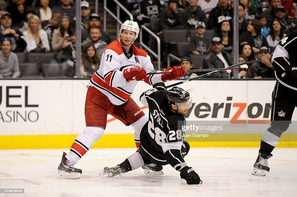<a gi-track='captionPersonalityLinkClicked' href=/galleries/search?phrase=Jordan+Staal&family=editorial&specificpeople=533044 ng-click='$event.stopPropagation()'>Jordan Staal</a> #11 of the Carolina Hurricanes throws the check against <a gi-track='captionPersonalityLinkClicked' href=/galleries/search?phrase=Jarret+Stoll&family=editorial&specificpeople=204632 ng-click='$event.stopPropagation()'>Jarret Stoll</a> #28 of the Los Angeles Kings at Staples Center on March 1, 2014 in Los Angeles, California.