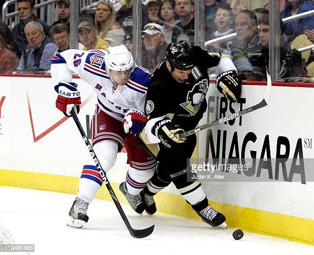 Jordan Staal of the Pittsburgh Penguins battles for the puck against Erik Christensen of the New York Rangers at Consol Energy Center on March 20...