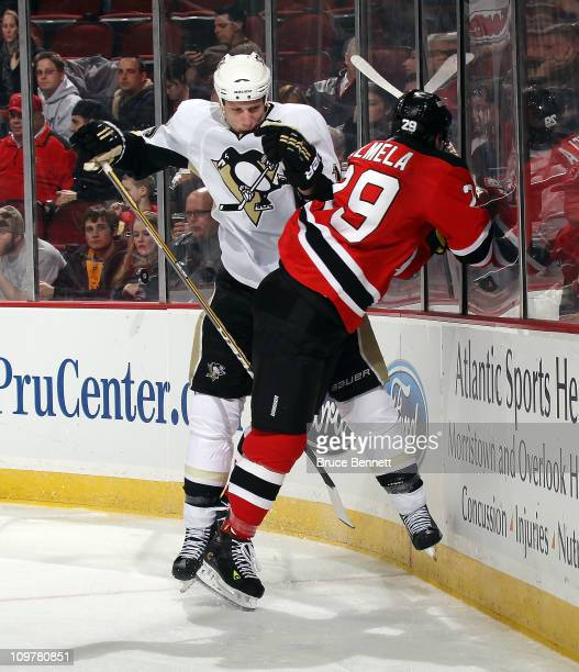 Jordan Staal of the Pittsburgh Penguins collides with Anssi Salmela of the New Jersey Devils at the Prudential Center on March 4 2011 in Newark New...