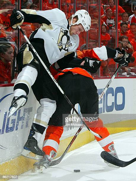 Jordan Staal of the Pittsburgh Penguins lays a hit against Andrew Alberts of the Philadelphia Flyers during Game Six of the Eastern Conference...