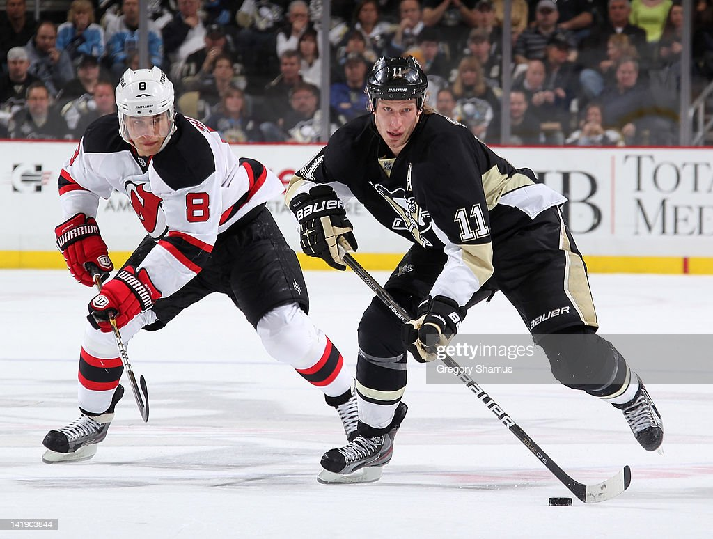<a gi-track='captionPersonalityLinkClicked' href=/galleries/search?phrase=Jordan+Staal&family=editorial&specificpeople=533044 ng-click='$event.stopPropagation()'>Jordan Staal</a> #11 of the Pittsburgh Penguins moves the puck in front of <a gi-track='captionPersonalityLinkClicked' href=/galleries/search?phrase=Dainius+Zubrus&family=editorial&specificpeople=204779 ng-click='$event.stopPropagation()'>Dainius Zubrus</a> #8 of the New Jersey Devils on March 25, 2012 at Consol Energy Center in Pittsburgh, Pennsylvania.