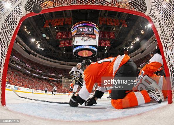 Jordan Staal of the Pittsburgh Penguins scores a first period goal against Pavel Kubina and Ilya Bryzgalov of the Philadelphia Flyers in Game Four of...