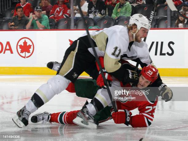 Jordan Staal of the Pittsburgh Penguins takes a penalty for elbowing against David Clarkson of the New Jersey Devils at the Prudential Center on...