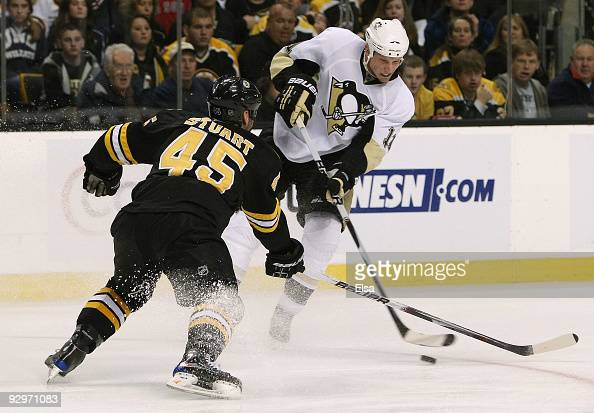 Jordan Staal of the Pittsburgh Penguins takes a shot as Mark Stuart of the Boston Bruins defends on November 10 2009 at the TD Garden in Boston...
