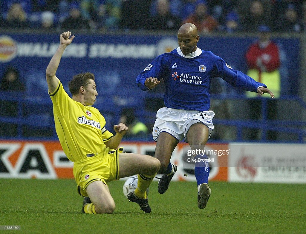 Jordan Stuart of Leicester gets past Matt Holland of Charlton during the FA Barclaycard Premiership match between Leicester City and Charlton Athletic at Walkers Stadium on November 22, 2003 in Leicester, England.