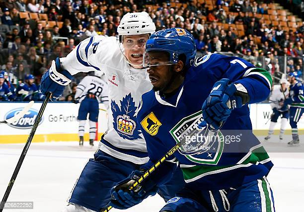 Jordan Subban of the Utica Comets battles with Colin Greening of the Toronto Marlies during game action on November 26 2016 at Air Canada Centre in...