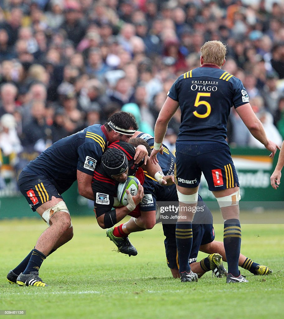 Jordan Taufua of the Crusaders is hit hard in the tackle of two Highlanders during the Super Rugby trial match between the Highlanders and the Crusaders at Fred Booth Park on February 11, 2016 in Waimumu, New Zealand.