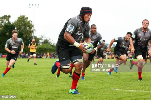 Jordan Taufua of the Crusaders makes a break during the Super Rugby preseason match between the Hurricanes and the Crusaders at Border Rugby Club on...