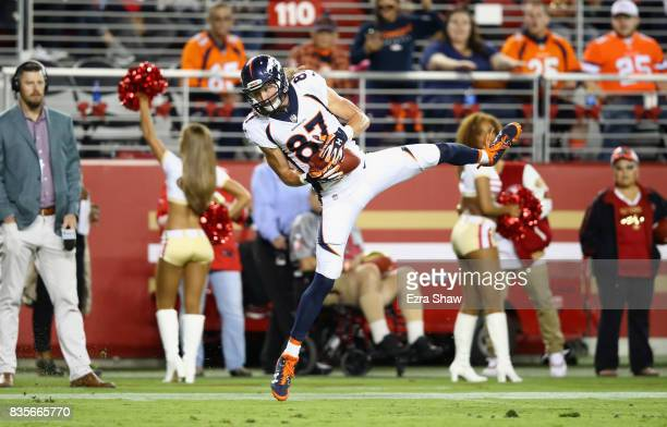 Jordan Taylor of the Denver Broncos catches the ball and then runs in for a touchdown against the San Francisco 49ers at Levi's Stadium on August 19...