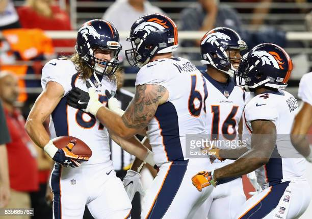 Jordan Taylor of the Denver Broncos is congratulated by Connor McGovern after he scored a touchdown against the San Francisco 49ers at Levi's Stadium...