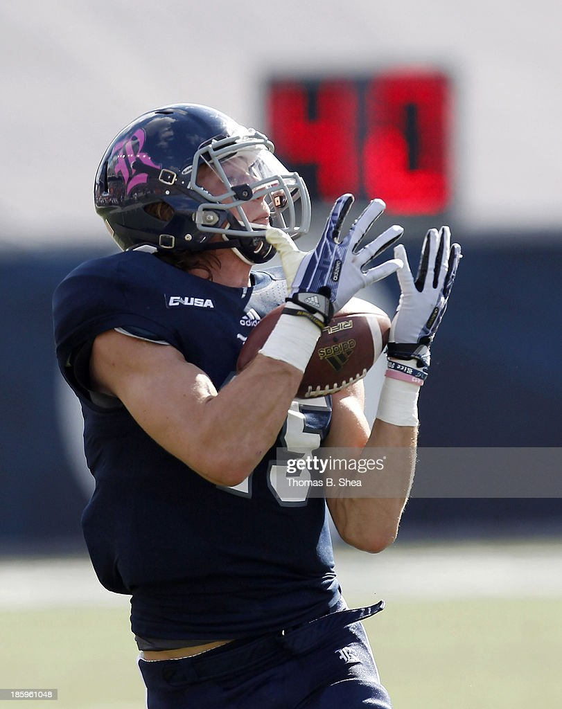 Jordan Taylor #15 of the Rice Owls makes a reception against the UTEP Miners on October 26, 2013 at Rice Stadium in Houston, Texas.