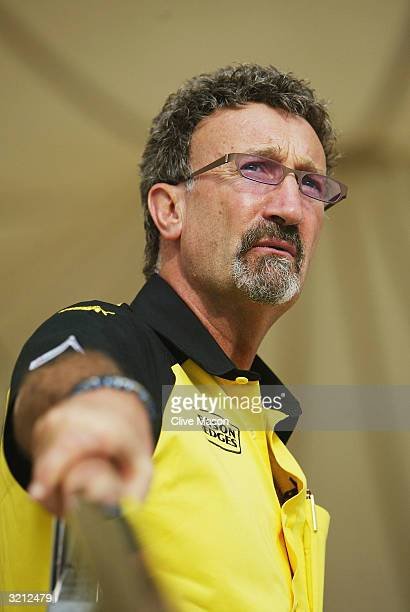 Jordan team boss Eddie Jordan stands talking in the paddock after qualifying for the Bahrain F1 Grand Prix at the Bahrain Racing Circuit on April 3...